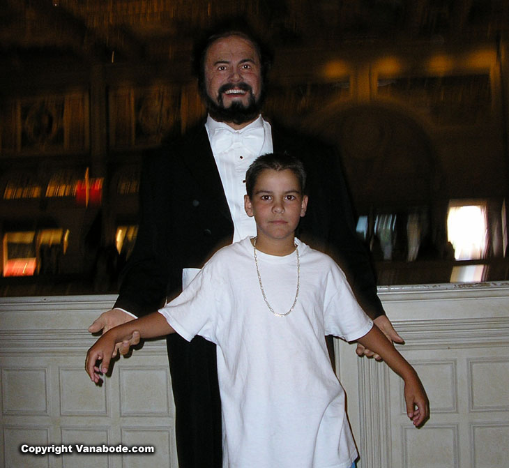 picture of ben posing with pavarotti in las vegas
