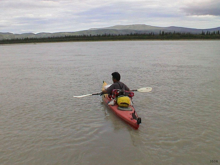 picture of kayaker floating on Charley River National Preserve Alaska