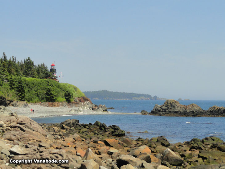 lighthouse from rocky beach in maine