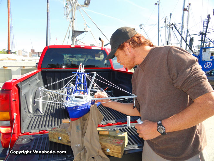 portuguese fisherman-makes model boats and sells from his truck