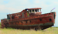 rusty boat on land