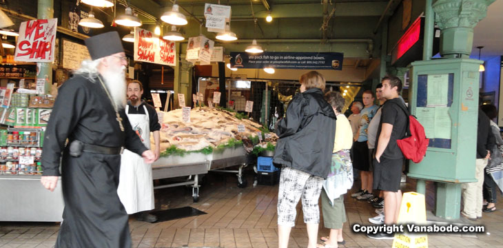 picture of passer bys in seattles seafood market